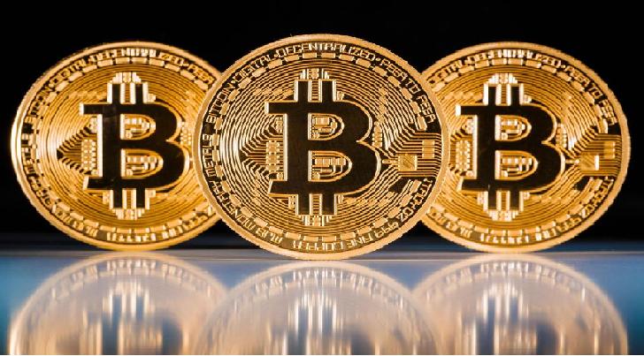 Le Bitcoin explose la barre des 10.000 $. Effet bulle ?
